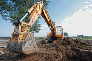 excavator digging a trench for the pipeline